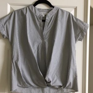 Short sleeve, cropped, collarless blouse